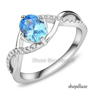 WOMEN'S OVAL CUT AQUA CZ STAINLESS STEEL INFNITY ENGAGEMENT RING BAND SIZE 5-10