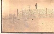 RPPC Tama IA Farm Scene Man Standing Atop Mountain of Corn Cobs 1912