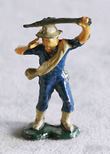 Cast metal vintage man with machete hacking his way through the jungle 2 3/8""