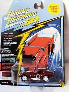 Johnny Lightning 1/64. Shelby Cobra Daytona coupe burgundy  Neuf sous bister