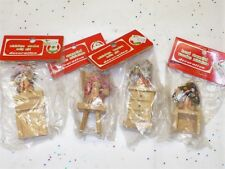4 VINTAGE COMMODORE CHRISTMAS WOODEN ORNAMENTS GIRLS IN HATS ON CHAIRS NIP