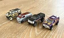 Hot Wheels Lot Of Four Dicast Trucks With Side Flames Hummer Dodge Van F-150