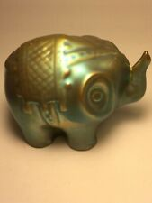 Unique Pottery elephant with blue glaze.