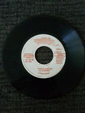 Ini Kamoze - World A Music / Call A Taxi 45 Jamaican press