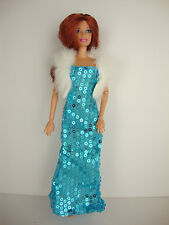 A Teal Blue Sequined Gown with Slit in One Side Includes a White Fur Jacket
