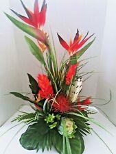 Tropical table centerpiece.  Silk flower floral arrangements