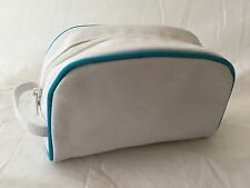 Small tough white cotton bag containing lugagge straps