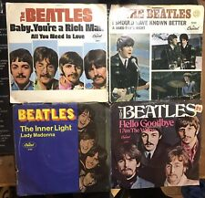 4 beatles 45s with sleeves Including The Rare Hello Goodbye And I Am A Walrus