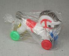 BH-030 -- Jouet de bazar -- Petit cheval sur roulettes -- Fond de stock