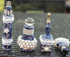 #9911. Vintage glass bottles upcycled by Merle. Set of 4. Decoupaged.