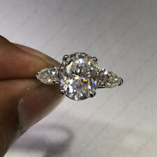 14k Rose Gold 2.96 Oval 3-Stone Colorless Brilliant Moissanite Engagement Ring