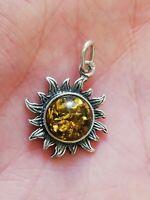 Pendentif soleil en argent massif et ambre