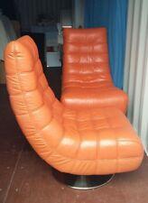orange retro 60's-70's style leather swivel chairs