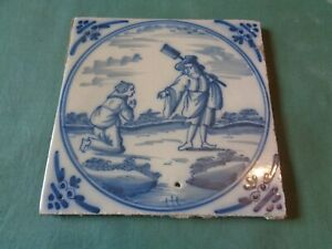 18 th CENTURY DELFT TILES  BLUE WHITE   MAN WITH SHOVEL ( X )