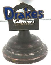 A GOOD VINTAGE ADVERTISING LETTER HOLDER. DRAKES LIMITED.