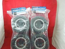 4 PRO-LINE BADLANDS MX43 Pro-Loc MOUNTED TIRES + WHEELS TRAXXAS X-MAXX XMAXX NEW