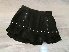 Euc Girls Justice black flippy skort with silver accents, size 6/7
