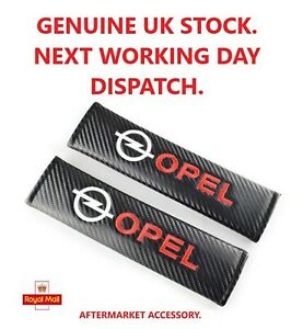 Seat Belt Pads.  Carbon Fibre Effect.    1 Pair.  (Will Fit OPEL)