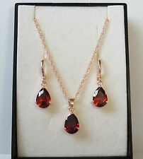 18k Rose Gold Plated Pear Cut Red CZ Earrings and Pendant Necklace Set.