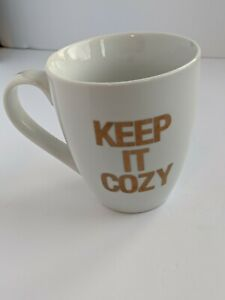 Keep it cozy gold and white coffee mug cup