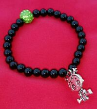 Pulsera elastica grano bolas color negro brillante y verde strass mas niño mama