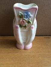 Ceramic Flowered Vase With Hands Holding It