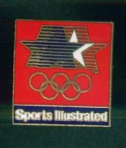 LOS ANGELES 1984  OLYMPIC GAMES. SPONSOR PIN/BADGE. SPORTS ILLUSTRATED. RED