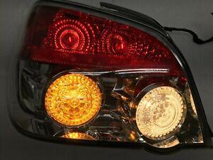 2006 - 2007 Subaru Impreza OEM Driver Side Tail Light ( LH / Left Brake Light )