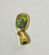 Black Opal 14K Gold oval pendant with vivid red gold green blue colours