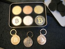 bit coin collection in display case  + keychains