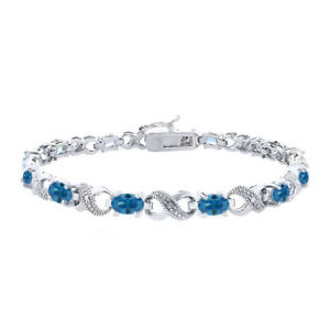 Blue Topaz & Natural Diamond Accent Infinity Bracelet in Brass, 6.6ct TGW