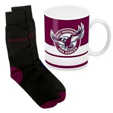 125055 MANLY SEA EAGLES NRL 330ML COFFEE MUG AND KNIT ADULT FIT SOCKS GIFT PACK