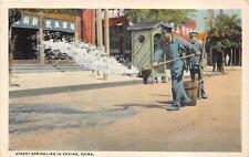 STREET SPRINKLING IN PEKING CHINA OCCUPATION POSTCARD (c. 1915)