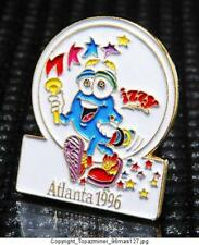 OLYMPIC PINS 1996 ATLANTA GEORGIA USA MASCOT IZZY HOLDING TORCH STARS