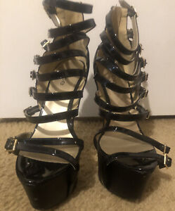 Bebe Black Stiletto Heels With Gold Buckles.Size 8