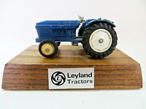 DINKY 308/384 'LEYLAND FARM TRACTOR'. MOUNTED ON WOODEN PLINTH.
