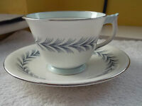 AYNSLEY CHINA CUP AND SAUCER  FEATHER LIKE PATTERN  PALE BLUE TRIM