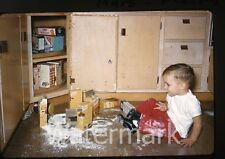 1960s Kodachrome photo slide Young boy  makes a mess with cake mix and sugar