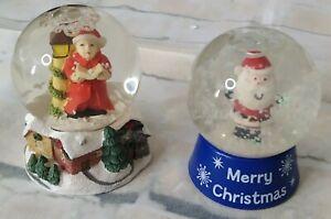 "2 Small Christmas Snow Globes 2.25"" Tall, Carol Singer & Santa"