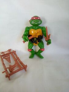 Vintage Teenage Mutant Ninja Turtles figure. Raphael.1988. With Original Weapons