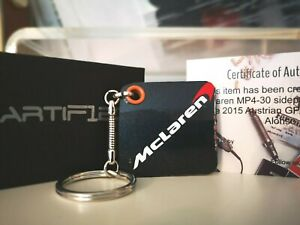 Genuine Race Used 2015 McLaren F1 carbon fibre sidepod bodywork keyring. Alonso