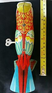 VNTG. BIRD TIN TOY PARROT JUMPIN WIND UP CHINA JAPAN RUSSIA GERMANY & KEY WORKS