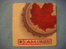 Beer Coaster ~><~ MOLSON Lager Biere ~ I Am Canadian ~ Red Maple Leaf Cap Design