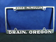 Dale McMullin DRAIN, OREGON Dealer Embossed Metal License Plate Frame Oversized