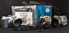 2 Minolta Dimage 7 Camera's W/Accessories For Repair or Parts