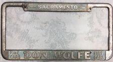 """Vtg (SACRAMENTO-CAR DEALER)~""""DON WOLFE""""~1932-1973~LICENSE PLATE FRAME~ships Free"""