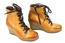 Buffalo Stiefel und Stiefeletten mit Keilabsatz für Damen