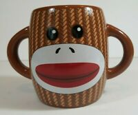 Galerie Sock Monkey Mug with two handles.  Monkey image on two sides.