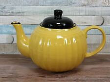 Yellow ceramic teapot with black lid and ribbed design afternoon tea
