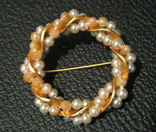 Lovely gold tone metal brooch with lovely false pearls approx 2 ins wide